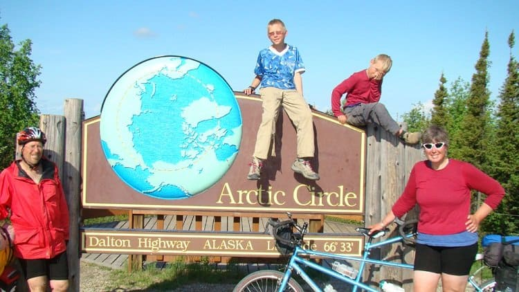 family on bikes at the arctic circle