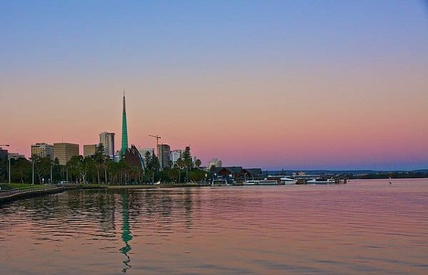 The sun sets over the city of Perth along the Swan River. Photo by berendsrob from Flickr.