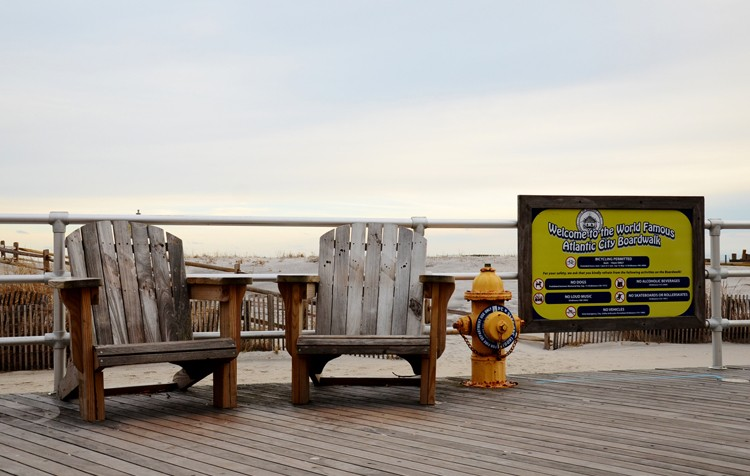 atlantic city boardwalk sign and chairs