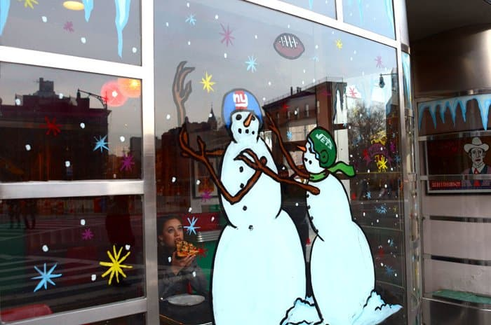 west village pizza joint with snowmen