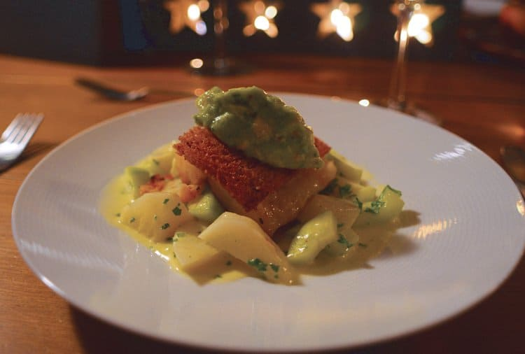 Red fish with avocado and potato