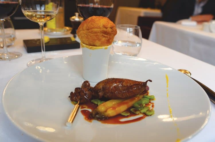 Pigeon breast with glazed turnips; the puff pastry sits atop a portion of giblet consomme with wasabi and lime - at Mere Brazier
